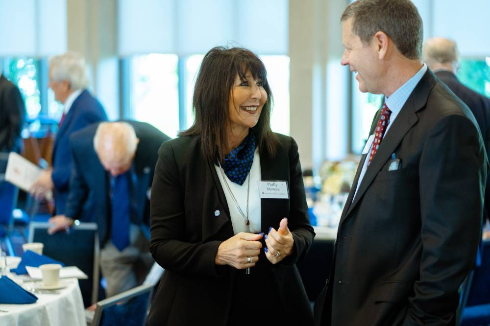 President Philomena V. Mantella mingling with a guest at the Foundation Annual Meeting